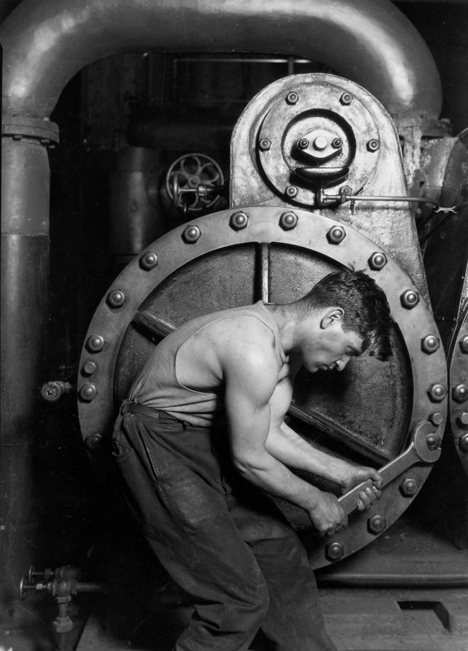 Lewis_Hine_Power_house_mechanic_working_on_steam_pump